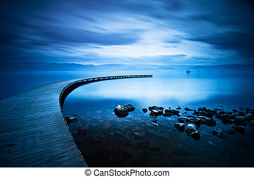 Blue sea and curve jetty
