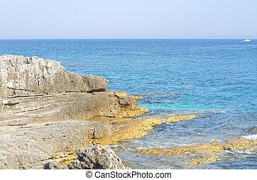 Blue Sea and Rocky Shore