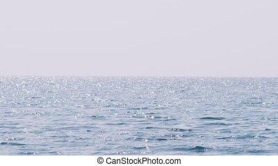 Blue sea and sky horizon, telephoto lens, 4k, sunlight glare...