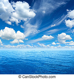 Blue sea and sky, white clouds, sunny weather