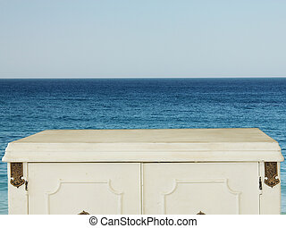 blue sea and sky with wooden vintage table background