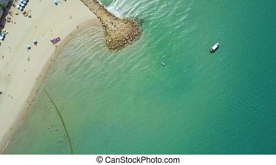 Blue sea and summer beach view from above flying drone. Aerial landscape sea boats sailing past sandy beach.