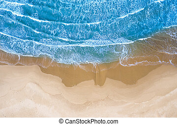 blue sea at the beach seen from above