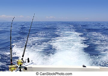 blue sea fishing sunny day trolling rod reels wake ocean big...