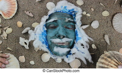 blue sea man scallop - funny blue man face with seashells...