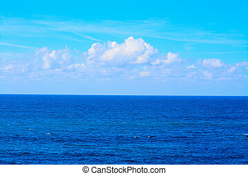 blue sea under soft clouds in Sardinia