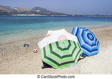 Blue sea water and beach on Marathonisi island in Zakynthos, Greece.