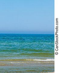 Blue sea water horizon and sky.