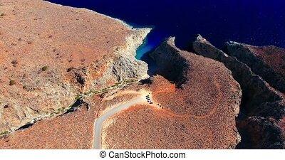Blue sea, waves breaking in cliffs at shore - Blue sea,...