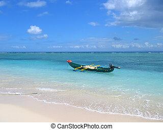 Blue sea with a small motor boat, Nosy Boraha, Sainte,Marie island, Madagascar