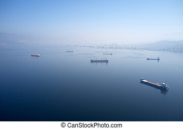 Blue sea with boats in the early morning.