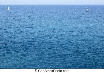 Blue sea with sailboat sailing the ocean surface summer vacation
