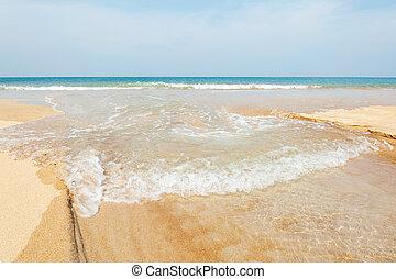 Blue sea with white sand beach