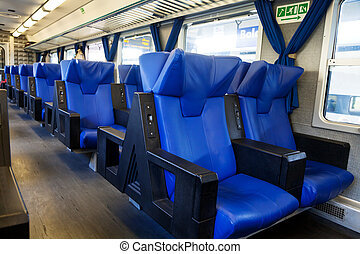blue seats in train - blue seats and interior of suburban...
