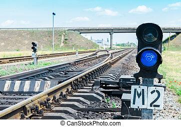 blue semaphore on railroad
