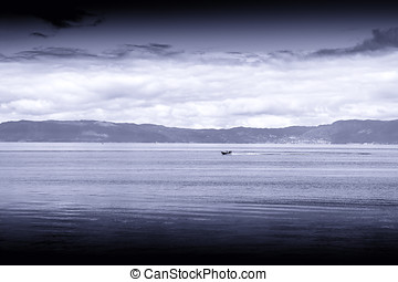 Blue sepia boat in Norway sea landscape background
