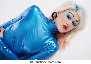 Blue - Sexy blond girl in blue latex dress and bright makeup...