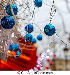 Blue shiny balls on Christmas street in Paris, France