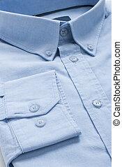 Blue Shirt - New folded blue men shirt, close-up macro