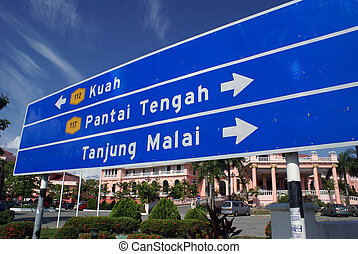 Blue sign on the road, Langkawi, Malaysia