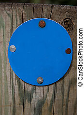 Blue Sign on Wooden Post
