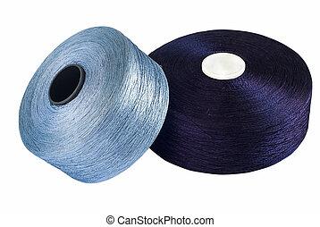 Blue silk yarn rolled on coils