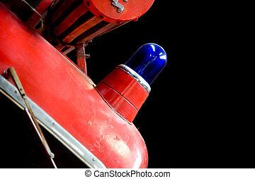 Blue siren on a red firetruck