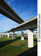 Blue skies and green grasses surround South Florida expressways.