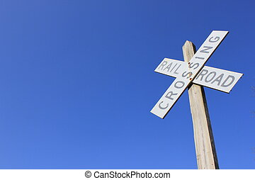 Blue skies and railroad sign - Brilliant blue skies as...