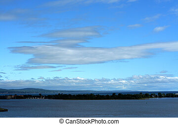 Blue skies over lake - Brilliant blue skies over lake with ...