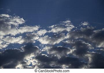 Blue sky among clouds
