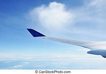 Blue sky and airplane wing