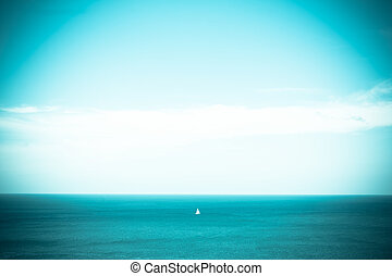 Blue sky and blue sea with loney ship, vintage tone
