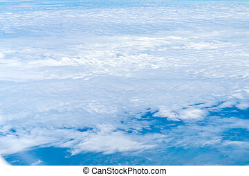 Blue sky and Cloud Top view from airplane window,Nature background.