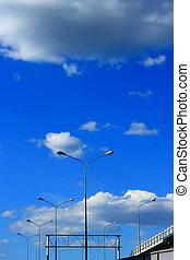 Blue sky and cloud with light pole