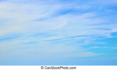 Blue sky and clouds - Blue sky and fast light white clouds -...