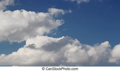 Blue Sky and Clouds Loop - Loop features white clouds...