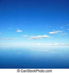 Blue sky and clouds with reflection on sea water
