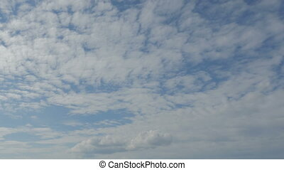 Blue sky and fluffy clouds.  time lapse