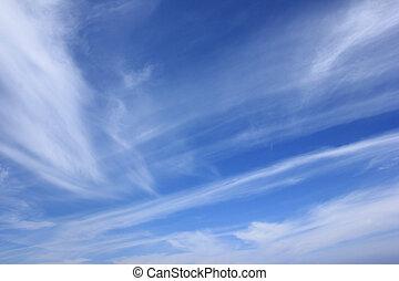 Blue sky and light white summer clo