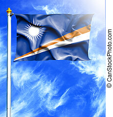 Blue sky and mast with hanged waving flag of Marshall Islands