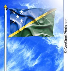 Blue sky and mast with hanged waving flag of Solomon Islands
