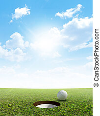 Blue Sky And Putting Green - A view of a perfectly manicured...