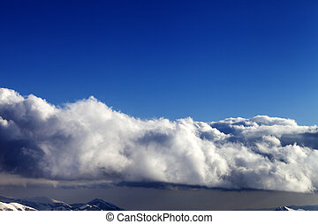 Blue sky and winter mountains