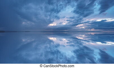 Blue sky at sunset with reflection, timelapse - Wide angle...
