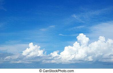 sky - Blue sky background with tiny clouds