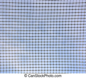 Blue sky behind the metal grid