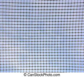 Blue sky behind the metal grid