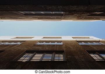 blue sky between old buildings