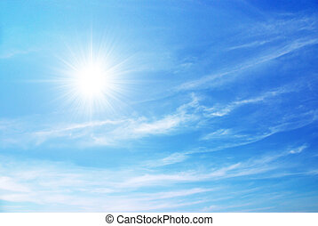 Blue Sky - bright blue sky with sun shining and some clouds